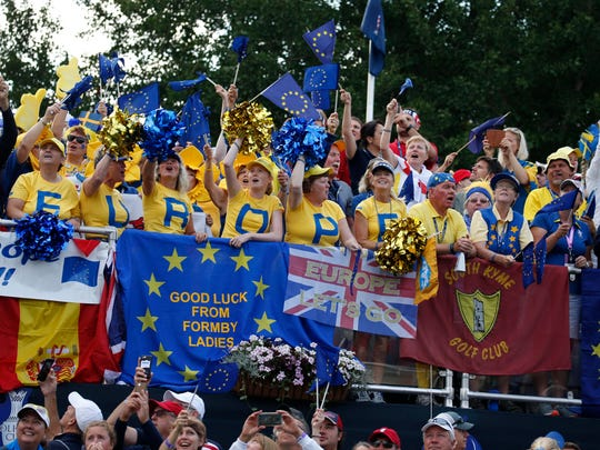 Europe fans cheer on the first tee during the first round morning session during The Solheim Cup international golf tournament at Des Moines Golf and Country Club.