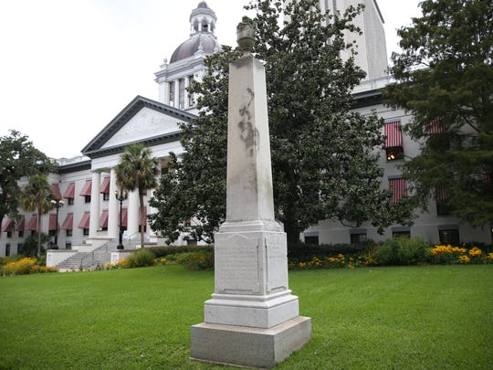 A Confederate monument, dedicated in 1882, stands in front of the Old Capitol.