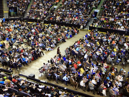 Jehovah's Witness watch as Ryan Parlegreco (not shown) talks during the Don't Give Up convention on Saturday, Aug. 19, 2017, at the American Bank Center in Corpus Christi.
