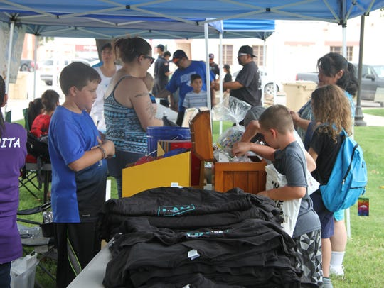 Students collect free items and school supplies at