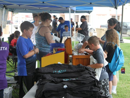 Students collect free items and school supplies at the Back to School Block Party, Saturday, Aug. 19, 2017. Supplies included backpacks, pencils and glue.