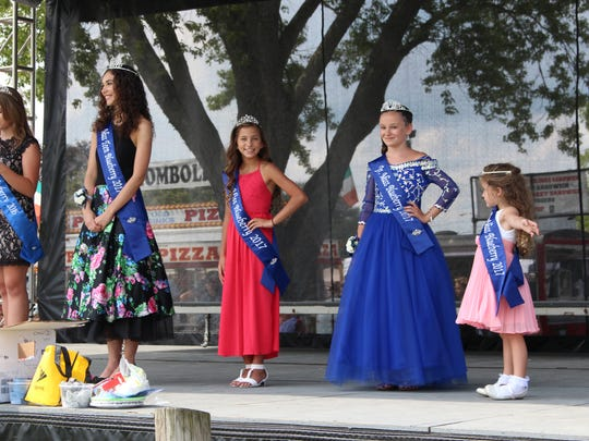 Winners of the Miss Blueberry pageants pose on stage during the Lexington Blueberry Festival on Sunday, Aug. 20, 2017. Sunday was the last day of the four-day festival.