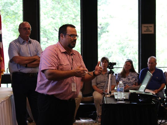 Mohican forestry manager Chad Sanders explains proposed changes to Mohican-Memorial State Forest's five-year plan during a meeting Monday, Aug. 21, 2017. The proposed changes would allow for the long-term removal of pine trees in hopes of developing a natural hardwood forest.
