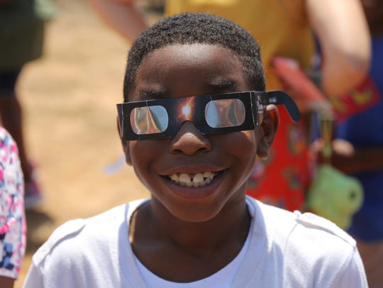 A Kate Sullivan Elementary student smiles in his solar