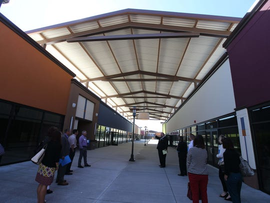 Metal canopies and fabric awnings are used throughout