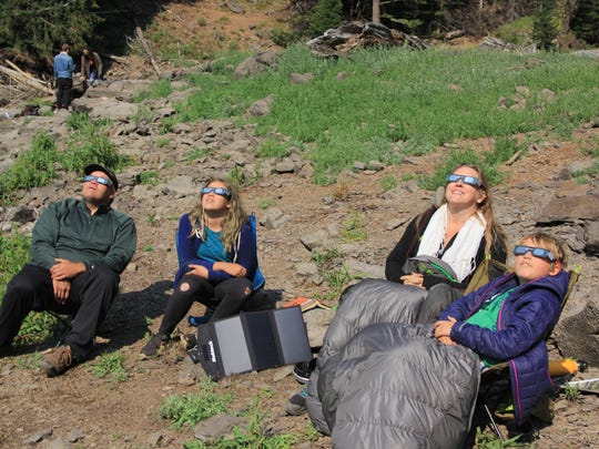 The Swan family watches eclipse at Strawberry Lake in Eastern Oregon's Strawberry Mountain Wilderness.