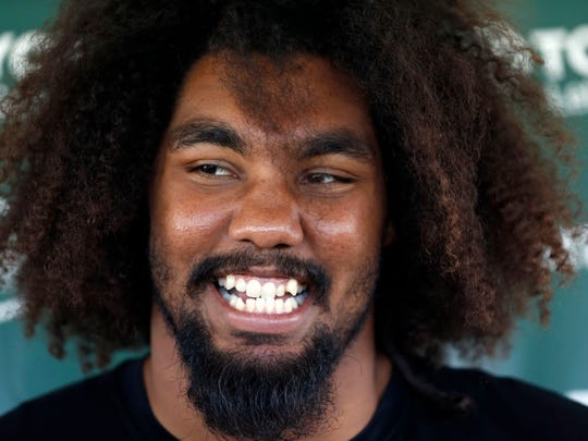 Jul 29, 2017; Florham Park, NJ, USA;  New York Jets nose tackle Leonard Williams (92) answers questions from media  at Atlantic Health Jets Training Center. Mandatory Credit: Noah K. Murray-USA TODAY Sports