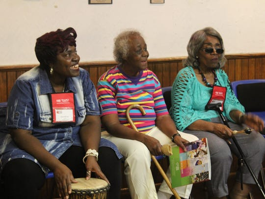 Woodie Ann Vaughns, center, sits with some of her visiting