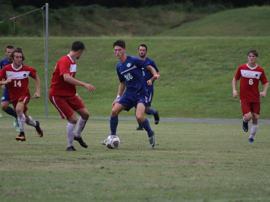 Pace native Chandler Castleman dribbles in an undated UWF men's soccer match. Castleman is recovering from a meniscus injury entering the 2017 season.