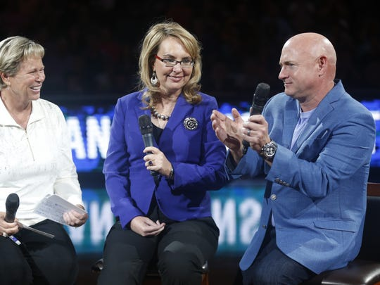 Gabrielle Giffords (center) answers questions from