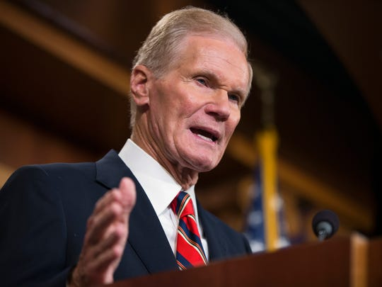 Sen. Bill Nelson speaks during a news conference on