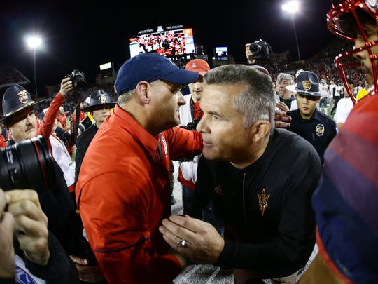 Arizona head coach Rich Rodriguez greets Arizona State head coach Todd Graham after the Wildcats defeated ASU in last year's Territorial Cup.