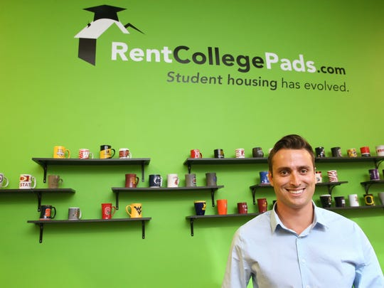 Dominic Anzalone, CEO of Rent College Pads Inc., displays coffee mugs bearing the college logo of some of the markets the company is in.