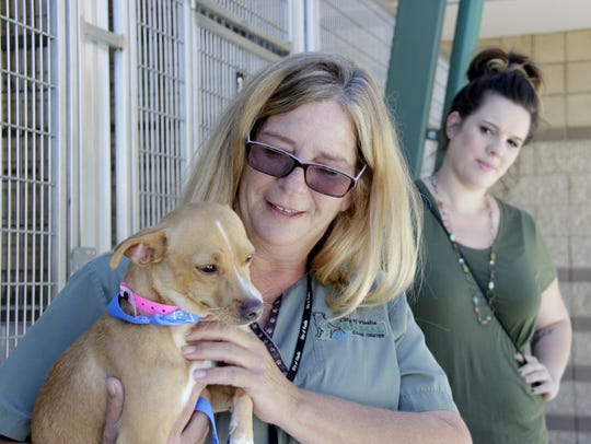 Lena Cooper, animal care manager, holds a newly adopted