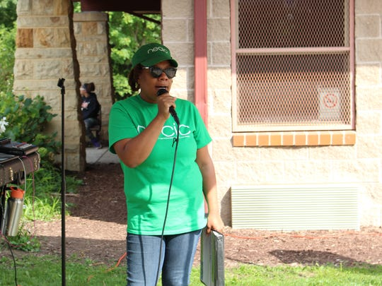 NECIC founder and executive director Deanna West-Torrence speaks to the crowd during NECIC's 10-year anniversary celebration at North Lake Park on Sunday, Aug. 27, 2017. Dozens of community members attended the celebration.