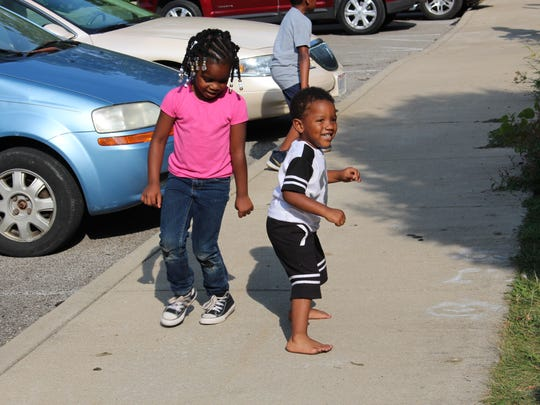 Children dance during NECIC's 10-year anniversary celebration at North Lake Park on Sunday, Aug. 27, 2017. Dozens of community members attended the celebration.
