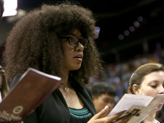 Aura Esterling reads the Seminole Creed along with