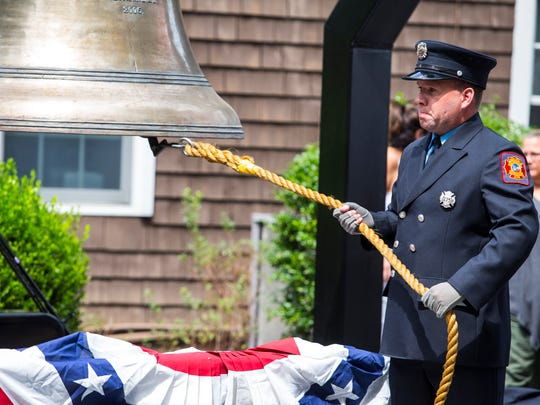 A September 11th Memorial Bell is rung in remembrance of fallen first responders who lost their lives during a memorial ceremony at the Delaware Fallen Heroes Benefit at Delaware Picnic Grove.