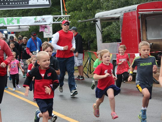 Kids take off in their running event at the Run for the Fallen in Kronenwetter in 2016.