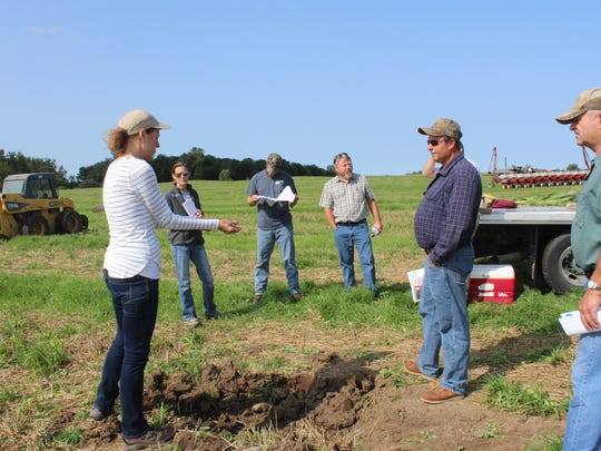 Becky Wagner of the Fond du Lac County Land & Water Conservation Department speaks about soil health during the Summer Field Day at the Hiemstra Dairy Farm near Brandon on Aug. 24.