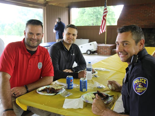 Plymouth Township Police Officers Jeff McParland, Josh McLean and Steve Coffell are all smiles at the third annual Kiwanis Club of Colonial Plymouth Barbeque for First Responders.