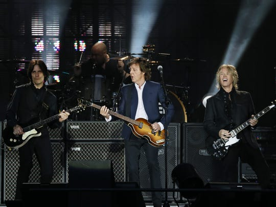Paul McCartney (C) performs along with US musicians Rusty Anderson (L), Brian Ray (R) and Abe Laboriel Jr. (back-C) on June 11, 2015 at the Stade de France in Saint-Denis near Paris.