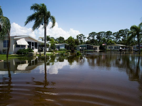 Water floods the streets of the Citrus Park community in Bonita Springs on Tuesday, Aug. 29, 2017.