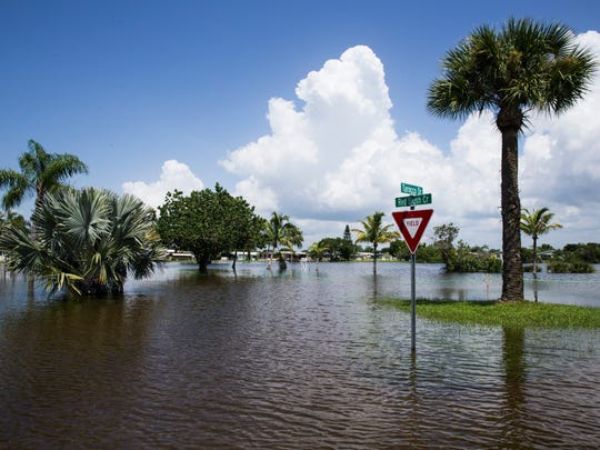 Water floods the Citrus Park community in Bonita Springs on Tuesday, August 29, 2017.