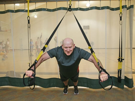 Riley Enright of Brookfield, uses body weight suspension training as part of of his workout at the Elite Sports Club in Brookfield.