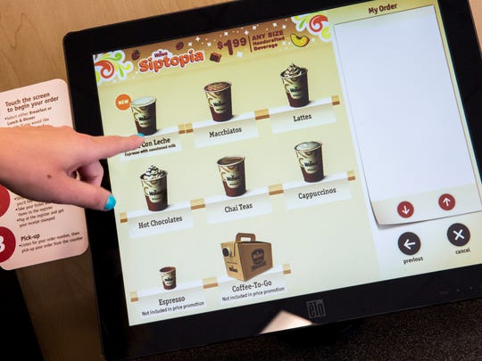 Alyson Mucha goes through the Built-To-Order¨ specialty beverages order screen at the new Naples' Wawa location on Radio Road. The 24-hour convenience store is set to open Thursday, Aug. 31.
