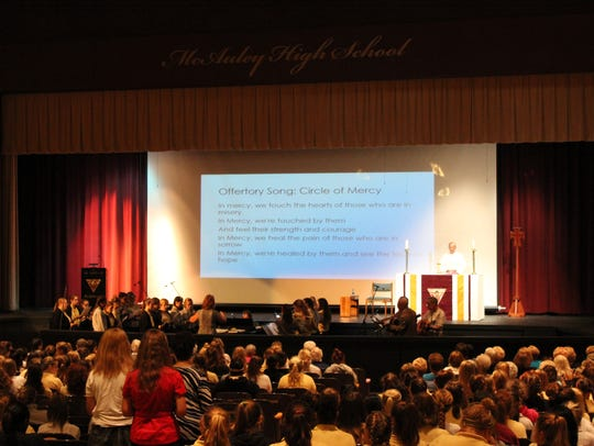 McAuley High School students, staff and alumni attend
