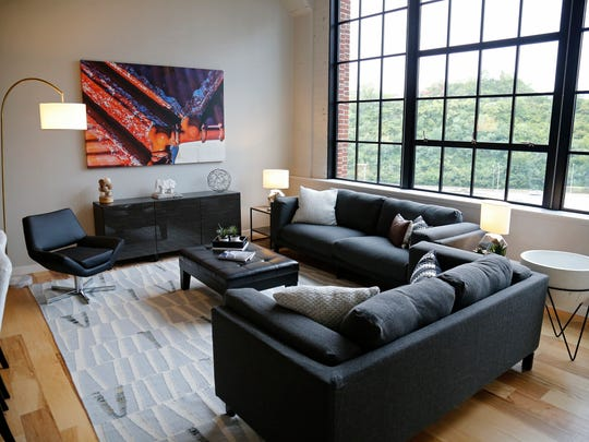 A furnished demo apartment on the 7th floor at the newly opened Baldwin apartments in Cincinnati on Friday, Sept. 1, 2017. Residents began moving into the repurposed former Baldwin Piano factory in June 2017.