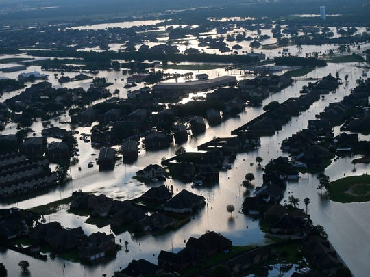 Floodwaters from Tropical Storm Harvey surround homes in Port Arthur, Texas,
