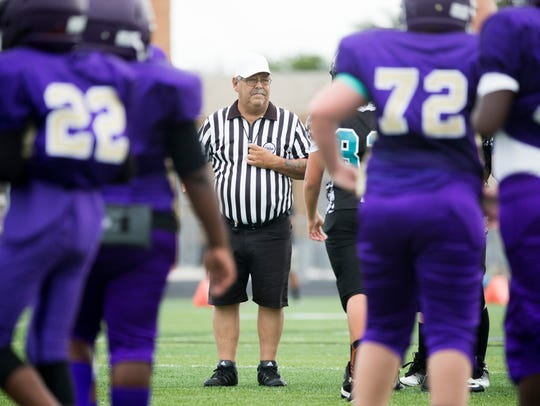 Collier County sports official Carmine DeCianni officiates