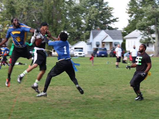 Team Lightning and Be Elite players go for the ball