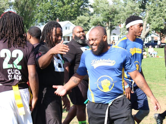 Team Lightning and Be Elite players shake hands after the Adult Flag Football League championship game Sunday, Sept. 3, 2017. Team Lightning won the game, 44-21.