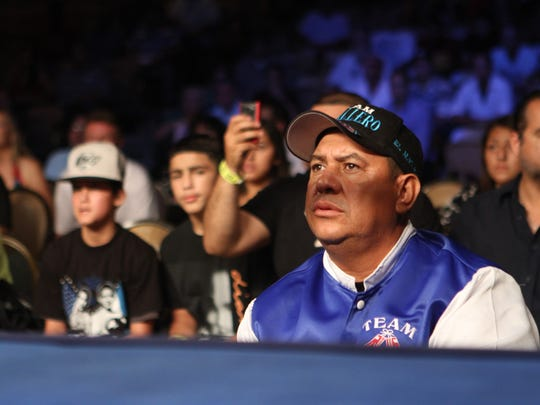 Marcos Caballero, the father of former world champion Randy Caballero, keeps an eye on his son during a fight.