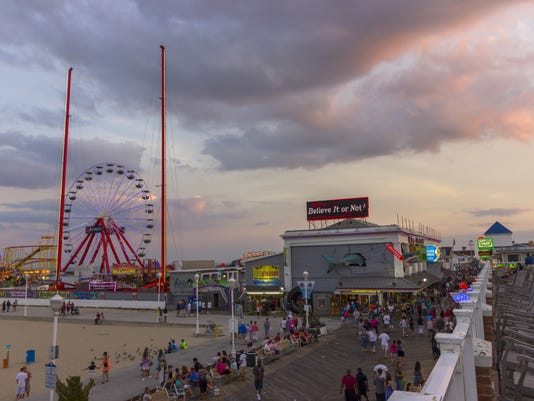 Ocean city, MD boardwalk and pier at sunset 2015