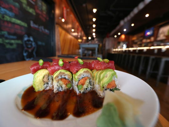 """""""Trust me Special"""" with spicy tuna, cucumber, asparagus, avocado, with eel and ponzu sauce at Izzy's Pub & Sushi one of brothers Viet and Nam Vu's restaurants."""