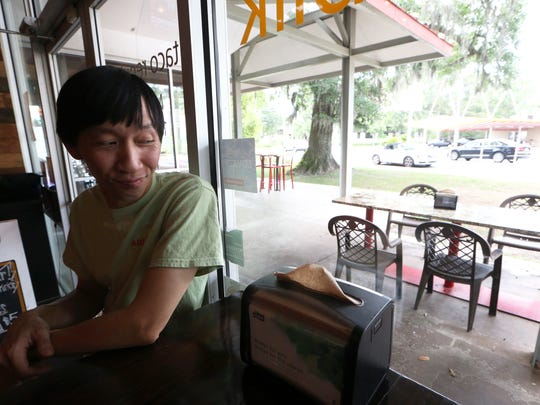 Nam Vu, owner of several local restaurants with his brother Viet, sits inside Taco Republik Wednesday, June 14, 2017.