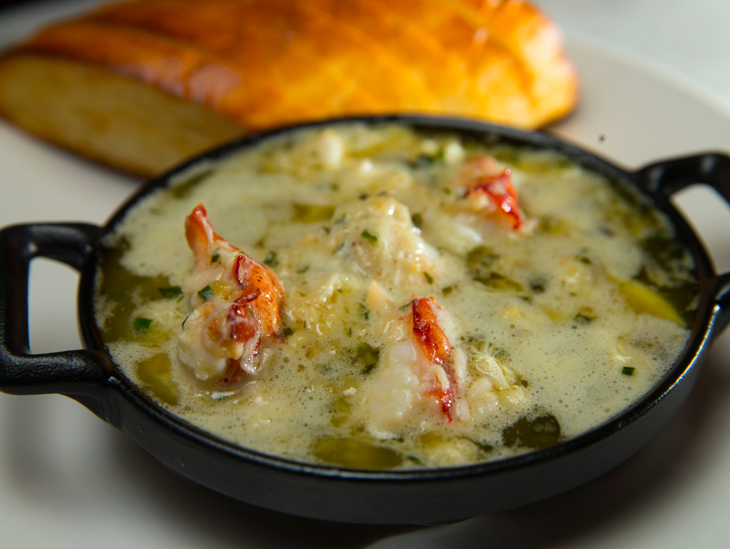 Lobster potholes, lobster and crab drenched in garlic