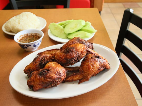 The crisp stuffed chicken wings at Kim's Thai, 938 W. Layton Ave. are served with the restaurant's complex hot sauce, cucumber and rice.