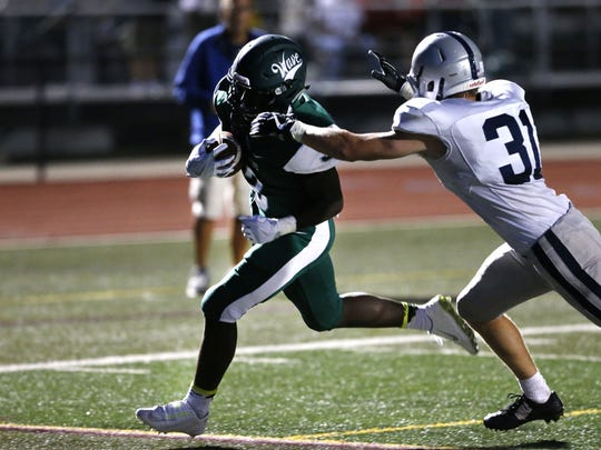 Long Branch running back Jermaine Corbett(3) beats James Male (31) of Manasqaun to the end zone for a touchdown during high school football game at Long Branch High School, Long Branch,NJ.  Friday, September 8, 2017.  Noah K. Murray-Correspondent Asbury Park Press