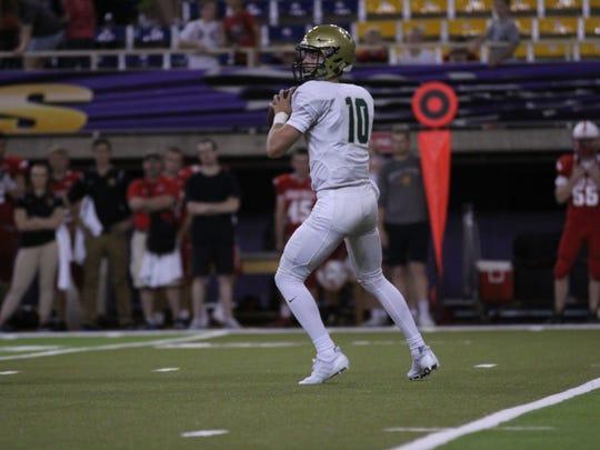 Iowa City West quarterback Evan Flitz drops back for a pass in the Trojans' Week 3 game at Cedar Falls.