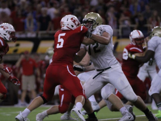 Iowa City West's Jonathan Gannon blocks Cedar Falls' Colin Klatt in a Week 3 game between the two teams.