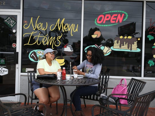 Jasmine Louis, left, and Kandice Asbury eat at the Lunchbox on Tennessee Street. The outside tables are popular with customers.