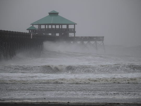 High waves slam into the Folly Beach Pier near Charleston