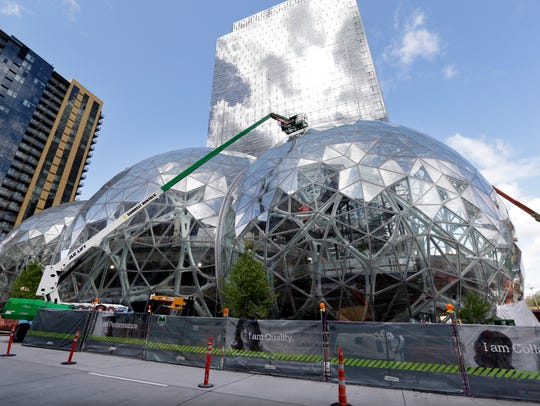 Three large, glass-covered domes are as part of an