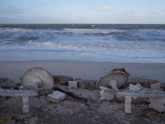 Benches and tables from Doc's Beach House, damaged