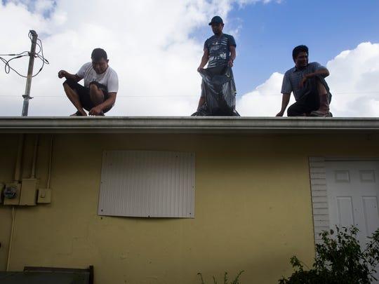 Maragarito Lucas, 37, from right, Francisco Juarez,